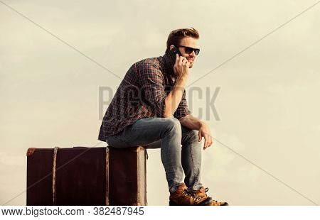 Calling Taxi. Travel Agency. Travel With Luggage. Travel Blogger. Man Sit On Suitcase Before Journey
