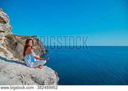 Yoga Time. Meditation. Contemplation. Female Sitting In Stylish Outfit. Lady Meditating On Nature. S