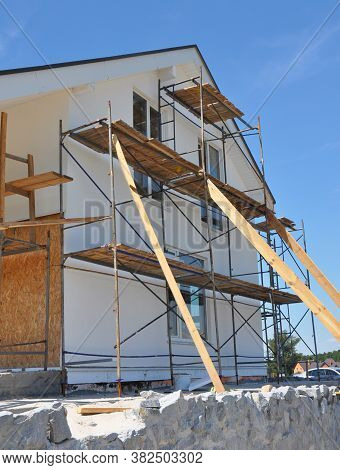 House Renovation Facade With Wall Insulation, Plastering, Paiting Walls. House Remodel Construction