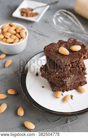 Brownie Cake With Almond Nuts On On Concrete Background. Traditional Chocolate Dessert