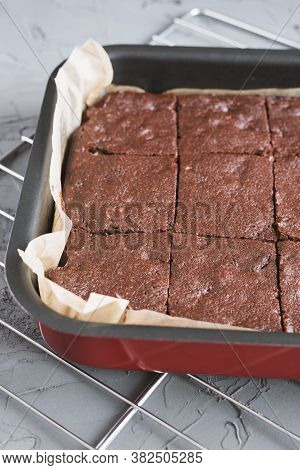 Homemade Chocolate Brownie In A Baking Pan Cut In Square Pieces. Fudgy Cake Recipe