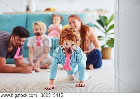 Happy Family Having Fun Together, Playing Funny Fetch Game At Home
