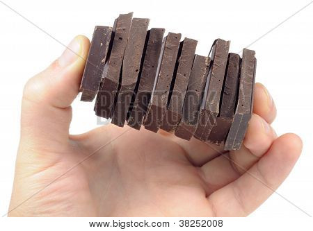 Chocolate Pieces In Hand