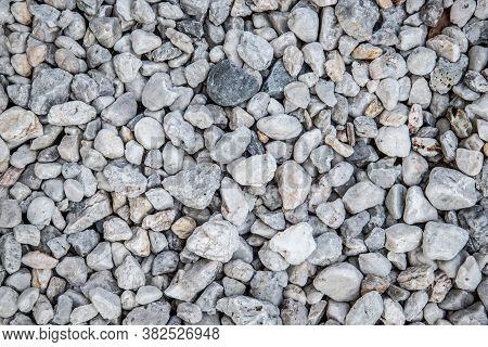 Texture Of White Small Garden Stones - White Pebbles Texture - Top View Of Small Stones On The Groun
