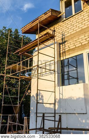Insulation Of House With Styrofoam. Scaffold On Building