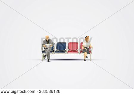 Social Distancing And New Normal Concept : Seated Passenger Sitting On Gate Airport Seat On Gray Bac