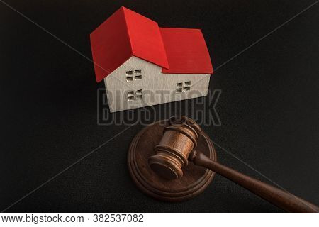 Mallet Of Judge And Model House. Real Estate Auction. Confiscated Housing