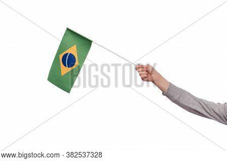 Hand Holding Brazil Flag Isolated On White Background. Ordem E Progresso.