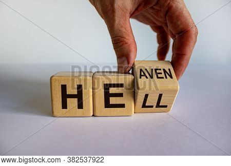 Hell Or Heaven. Hand Turns A Cube And Changes The Word 'hell' To 'heaven'. Concept. Beautiful White