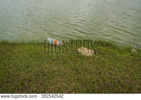 Jaisalmer, Rajasthan / India : August 17 2020 - Polluted Lake Plastic Bottles And Garbage At The Lak