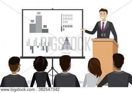 Caucasian Businessman Speaking To Audience From Tribune