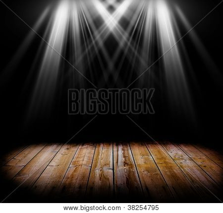 Two spot light on a wooden floor and a black background poster