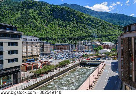 Cityscape The River Valira In Andorra La Vella City. Against The Backdrop Of The Mountains. Andorra