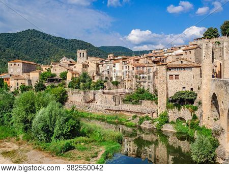 View Of The Historic Catalan City Of Besalu From The Moat And Walls. Costa Brava, Catalonia, Spain.