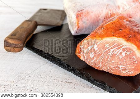 Frozen Raw Pork Neck Chops Meat Steak Isolated On Slate. Frozen Uncooked Slices Of Beef Steaks, Tend