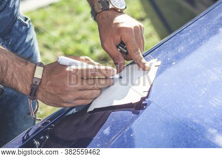 Male Hand Ready To Draw With White Marker