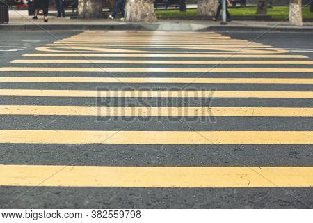 Yellow Pedestrian Crossing The Road In The City