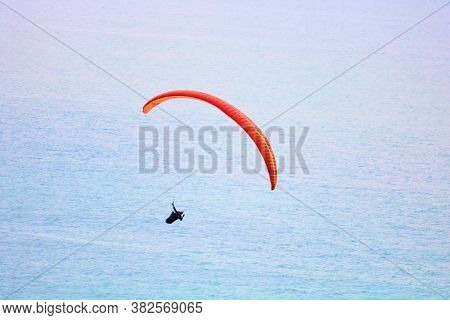 August 24, 2020 In La Jolla, Ca:  Person Paragliding Over The Pacific Ocean Taken From The Torrey Pi