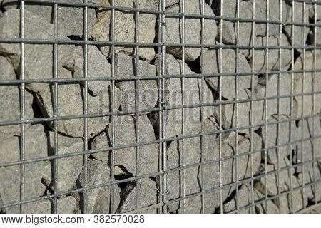 Decorative Gabion Fence Is Made Of Natural Stone And Metal Mesh.