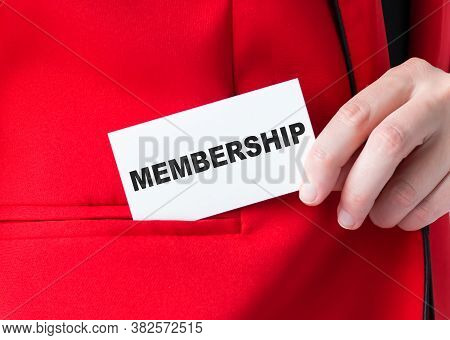 Businessman Putting A Card With Text Membership In The Pocket