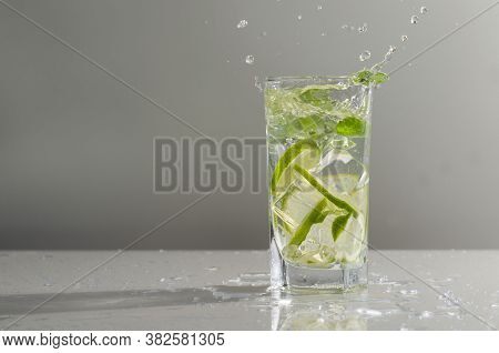 Mojito Cocktail With Lime And Mint In Tall Glass. Fresh Mojito In Glass On A Gray Background. Copy S