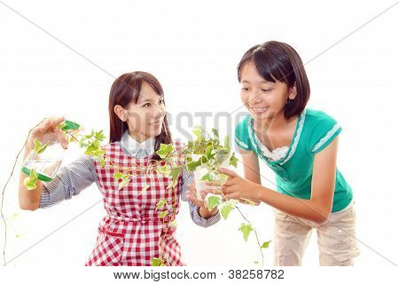 Parent and child who enjoy gardening