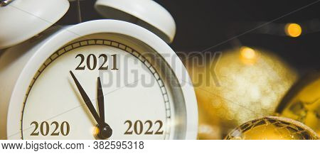 Change From 2020 To 2021 On The Clock. New Years Eve And Christmas. Alarm Clock And Christmas Golden