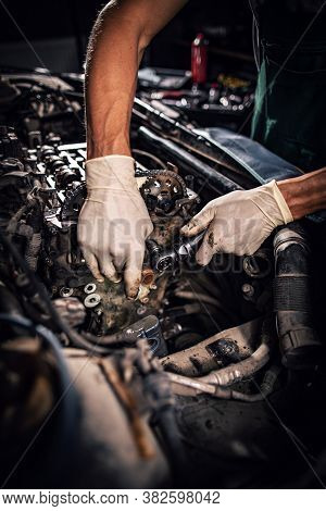 Hand Of Auto Mechanic With A Wrench. Car Repair Concept