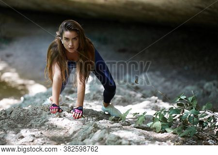 Fitness. Sport. Active Lifestyle. Nature. Woman With Flowing Hair Climbing On Cliff. Athlete In Spor