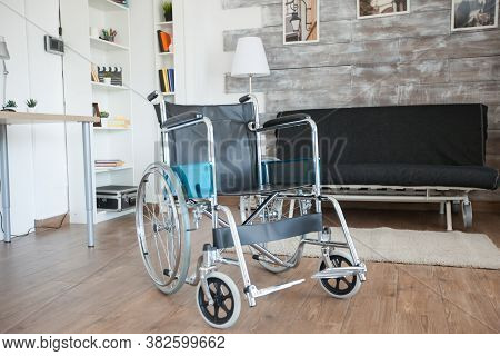 Wheelchair For Transportation Of Patient With Walking Disability In Nursing Home. No Patient In The