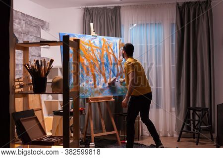 Successful Painter In Art Workshop Creating A Masterpiece. Modern Artwork Paint On Canvas, Creative,