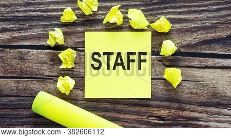 Staff . Notes About Staff Concept On Yellow Stickers On Wooden Background