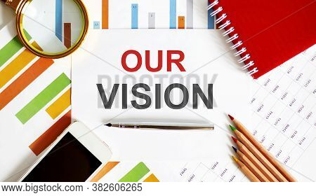 Text Our Vision On The Notepad With Office Tools, Pen On Financial Report