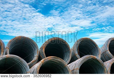 Steel Wire Coil Against Blue Sky. Metal Steel Reinforced For Concrete Construction. Iron Wire For Co