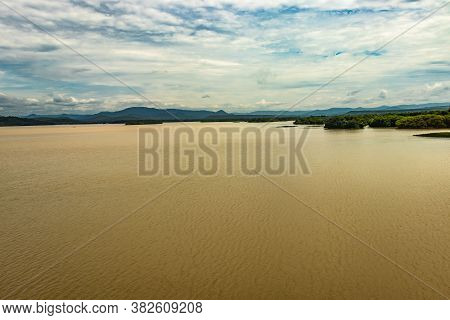 River Backwater With Mangrove Forest And Bright Sky