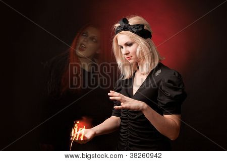 Witch sees a terrifying ghost on black background