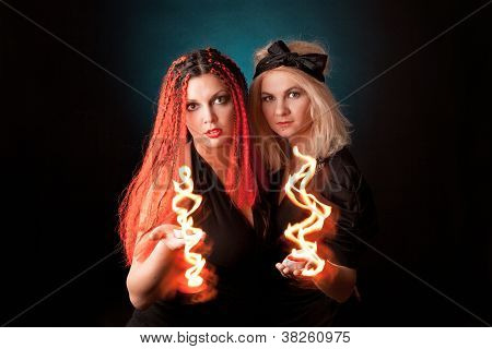 Two witches  practises witchcraft.