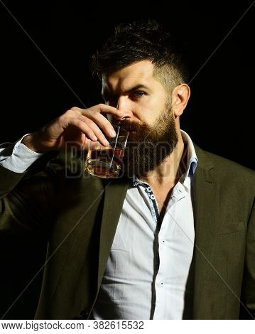 Connoisseur With Intelligent Look Drinks Cognac Or Brandy