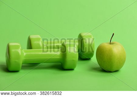 Sports And Healthy Regime Symbols. Apple Near Lightweight Barbells