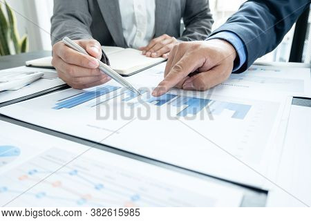 Two Business Leaders Talk About Charts, Financial Graphs Showing Results Are Analyzing And Calculati
