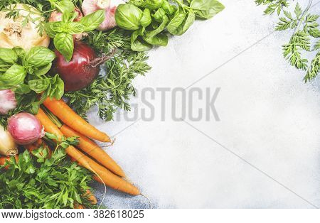 Assortment Of Fresh Root Vegetables And Spicy Herbs. Healthy Food, Summer Cooking Concept. Gray Back
