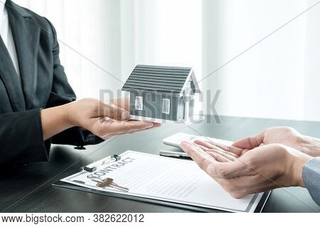 Real Estate Agent Broker Hand Over The Home To The New Owner After Completing The Signing According