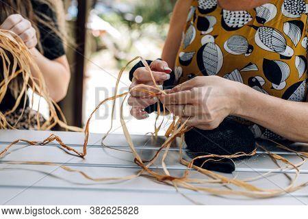 Female Weaving Basket On The Craft Workshop. Hands Holding The Craftwork, Close Up Shot.