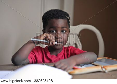 portrait of black child at a study table