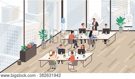 Group Of Office Workers At Working Place, Working On The Computer And Talking To Each Other. Office