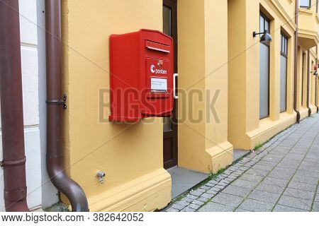 Alesund, Norway - July 27, 2020: Red Post Box Of Posten Norge (the Norwegian Post) In Alesund. Poste