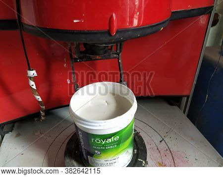Mumbai, Maharastra/india- April 12 2020: A Bucket Of Emulsion Paint Is Getting Prepared By The Mixin