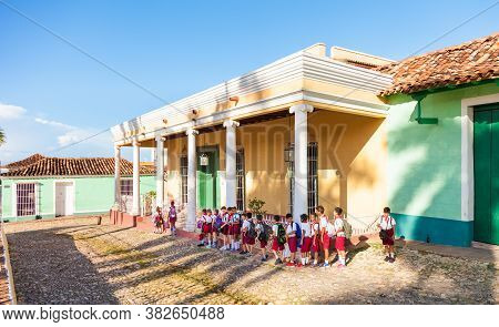 Trinidad, Cuba-october 14, 2016. Group Of The Young School Children, Cuban Pioneers, Walks At The Pl