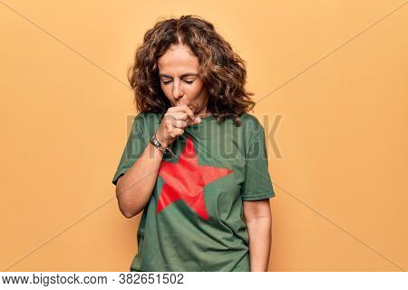 Middle age beautiful woman wearing t-shirt with red star revolutionary symbol of communism feeling unwell and coughing as symptom for cold or bronchitis. Health care concept.
