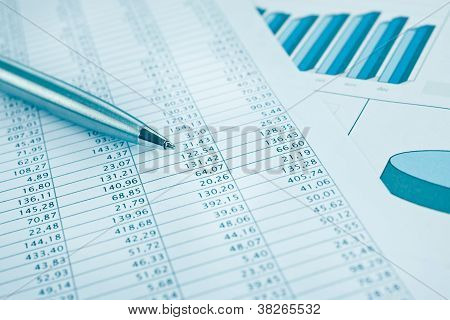 Business Data Report Print And Pen Close Up. Blue Toned.